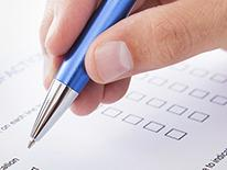 Photo of someone filling out a form